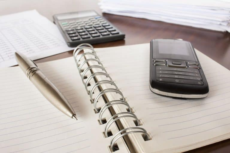 calculator on notepad working out the cost of owning a static caravan